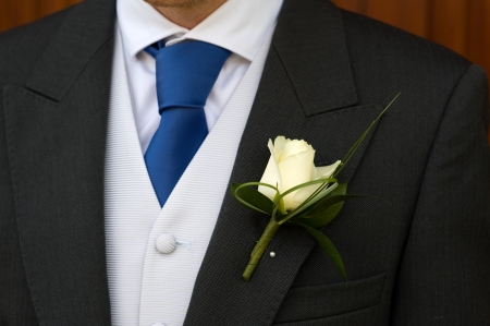 buttonhole: groom wearing a white rose buttonhole at wedding