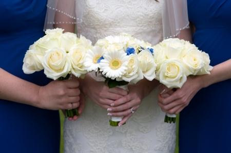 bridesmaids: bride and bridesmaids holding rose and gerbera wedding bouquet