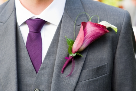 buttonhole: groom wearing a purple lily buttonhole Stock Photo