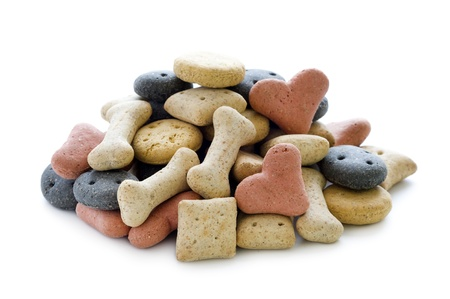 dog treat: dry dog biscuits in a heap isolated on white