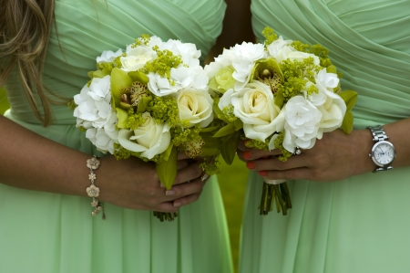bridesmaids: bridesmaids holding green wedding bouquets