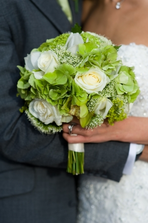 bouquet: bride and groom with wedding bouquet of white roses Stock Photo