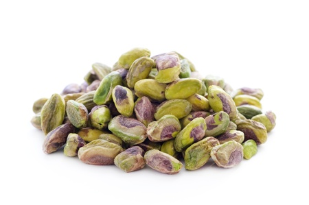 shelled whole pistachio nuts isoletaed on a white background,