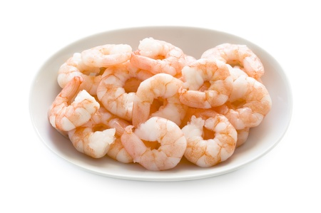fresh cooked king prawns in a dish isolated on a white background Standard-Bild