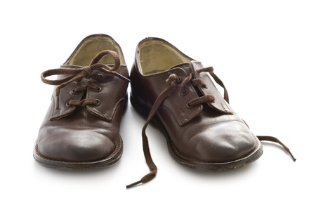 old shoes: a pair of vintage childs brown leather school shoes isolated Stock Photo
