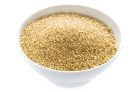 sugar bowl: granulated demerara sugar in a bowl isolated on white