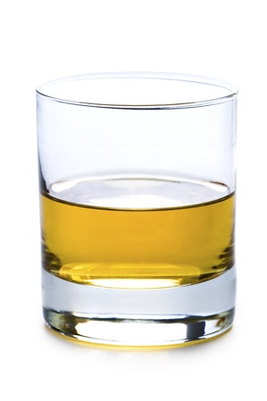 glass half full: a glass of whisky or whiskey  isolated on a white background