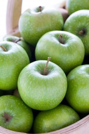 granny smith: green granny smith apples in a trug close up