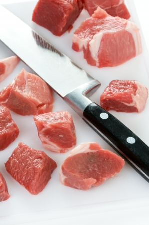 raw lamb diced with kitchen knife and chopping board Stock Photo - 15874330