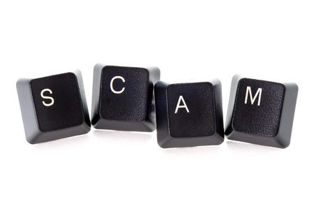 scam: computer keys spelling the word scam concept