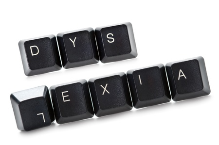 dyslexia: the word dyslexia spelled out in computer keypads