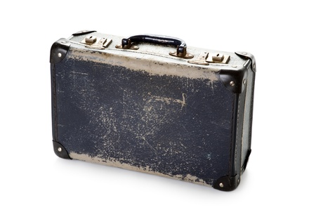 battered: a well worn battered vintage blue suitcase on white Stock Photo