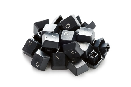 broken computer: a pile of computer keyboard keys isolated on a white background Stock Photo