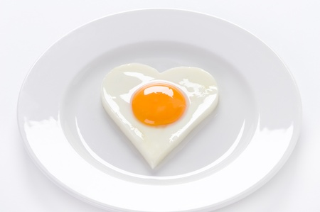 heart shaped cooked egg on a white plate Stock Photo - 16484489