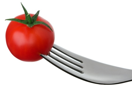 tine: cherry tomato on a fork against a white background Stock Photo