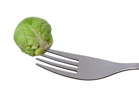 prongs: a single brussel sprout on a fork against white