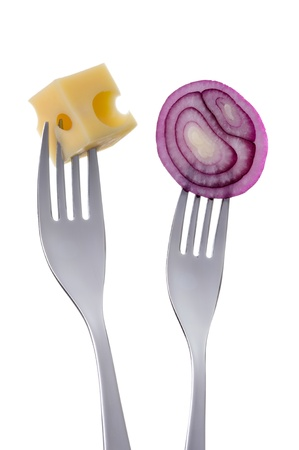 prongs: sliced red onion and emmental cheese on forks against a white background Stock Photo