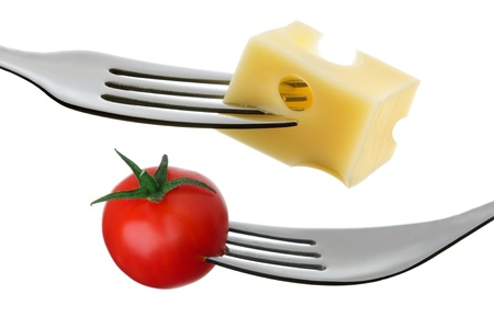emmental: cherry tomato and emmental cheese on a fork against white