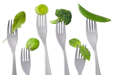 chlorophyll: raw green food on forks isolated against white background Stock Photo