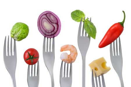 fresh healthy balanced food on forks isolated on a white background photo