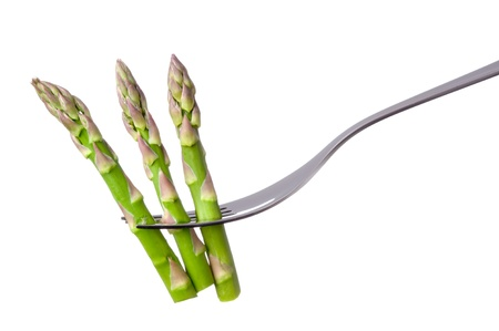 asparagus spears on a fork isolated against white background