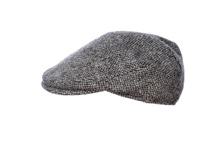flat cap: mans flat cap in grey tweed isolated on white background