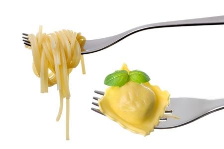 raviolo: spaghetti and ravioli pasta on forks isolated on white Stock Photo