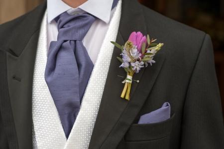 buttonhole: groom with purple flower buttonhole
