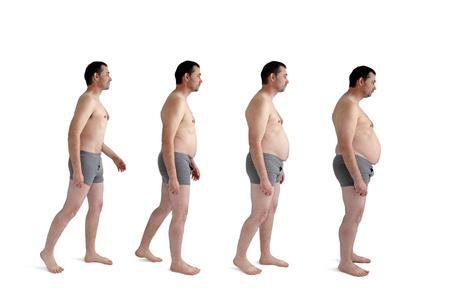 fatter: man making incremental weight gain Stock Photo