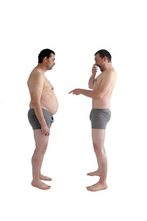 slim man laughs at his fat self Stock Photo
