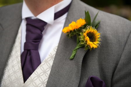 groom with sunflower wedding buttonhole photo