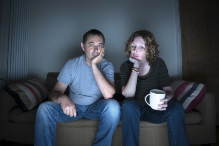 disinterested: couple watching television bored