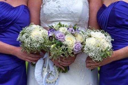 bridesmaids: bride and bridesmaids with wedding bouquets