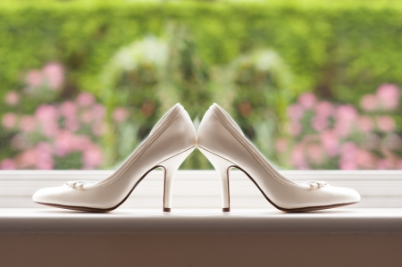 white wedding shoes of the bride by a window Stock fotó