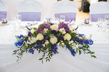 wedding table flowers in white and purple