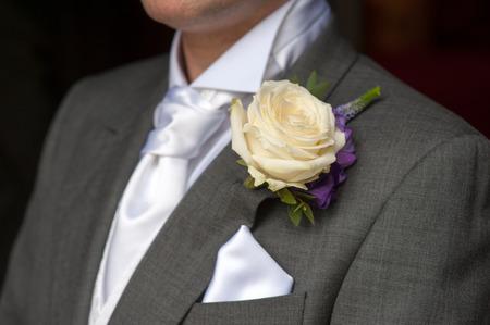 man wearing a rose buttonhole wedding flowers Stock Photo