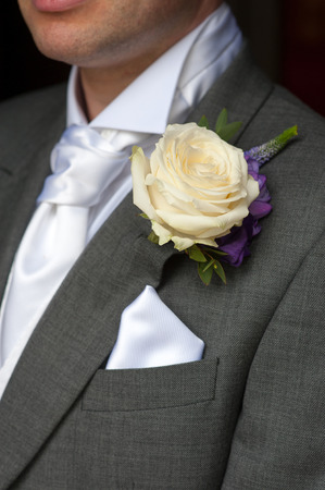 man wearing a rose buttonhole wedding flowers Stock Photo