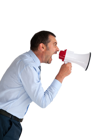 angry businessman with megaphone shouting isolated on white