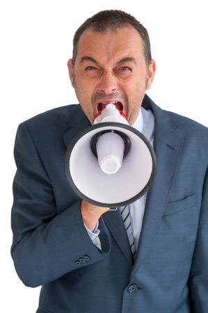 verbal communication: aggressive businessman shouting to camera through a loudhailer
