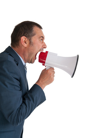 audible: business man shouting into a megaphone on white background Stock Photo