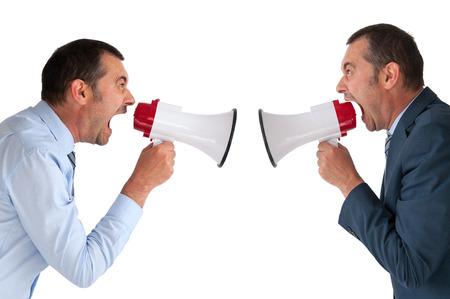 verbal communication: businessman yelling at himself through a loudhailer