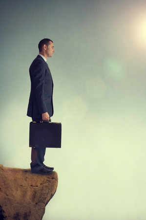 abyss: businessman standing on the edge of an abyss