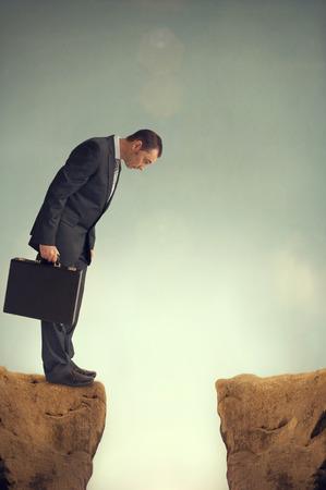 cliff edges: businessman on the edge of a ravine Stock Photo