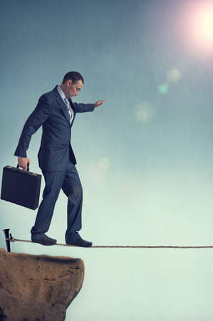 balancing businessman starting out on a tightrope  photo