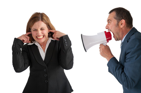businesswoman being yelled at by male manager on white