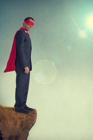 endpoint: superhero businessman standing on a precipice