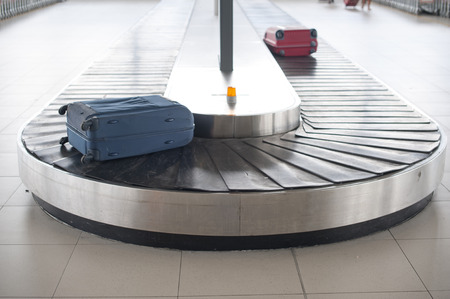 luggage airport: airport baggage carousel