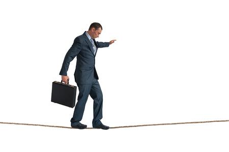 Geschäftsmann Balancieren auf einem Seil isoliert auf weiß Lizenzfreie Bilder