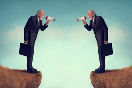 businessmen shouting through megaphones business conflict concept photo