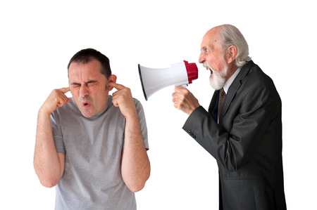 deafening: man being yelled at by senior male manager on white Stock Photo